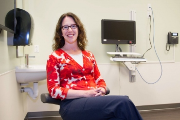 Vanessa Jacoby sits in an exam room