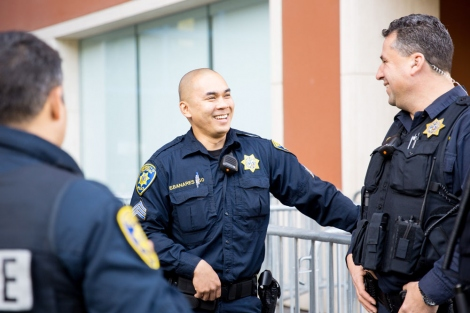 3 UCSF police officers chatting with each other
