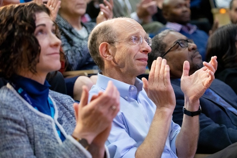 audience members clap during the State of the University address