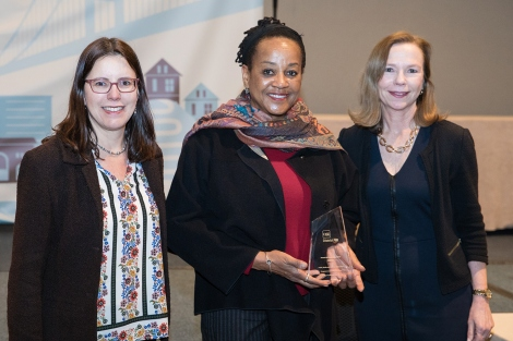 Christine Gasparac and Michele Davis receive a Gold Award at a CASE awards ceremony