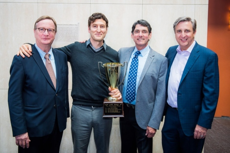 4 men pose with the UCSF AIDS Walk Trophy