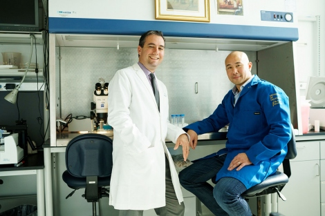 Ari Green and Jonah Chan pose in the lab