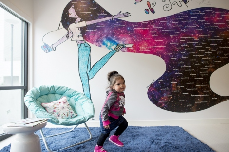 Joy Littlesunday runs around in Family House's new Mission Bay facility