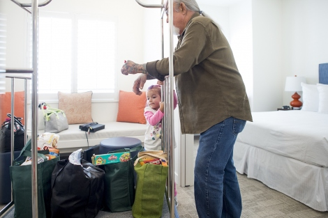 Four-year-old Rosalinda Talamantes and her uncle move belongings into Family House's new Mission Bay facility