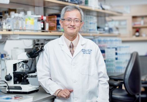 Hideho Okada in his lab