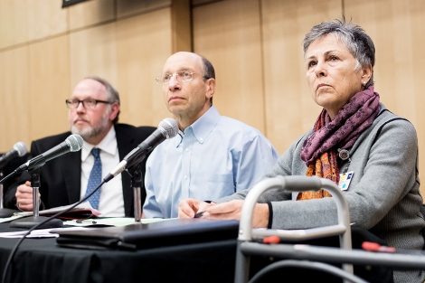 Brian Groves, Dan Lowenstein and Barbara French listen to a speaker during UCSF's immigration town hall