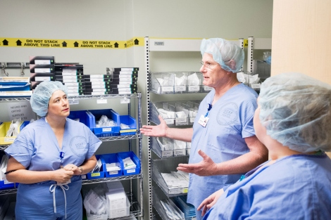 Mark Laret talking with staff in sterile core supply room