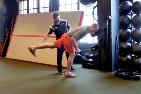 Matt Wetschler works out in a gym with a personal trainer