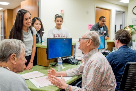 UCSF cardiologists Howard Kline and Mel Scheinman review test results with Lowell High School students Renee Markels, Kelly Chan and Isabella Covarrubias during the May 21 PlaySafe event.