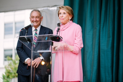 Joan Weill, on stage with husband Sandy Weill, addresses the UCSF neurosciences community during the celebration