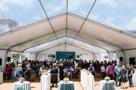 The UCSF neuroscienes community mingles in the tent set up for the event to celebrate the launch of the UCSF Weill Institute for Neurosciences