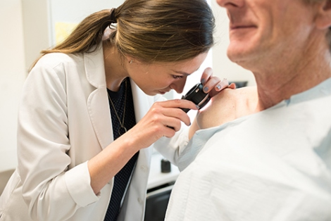 Dermatologist conducting a skin cancer screening