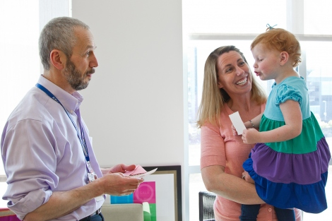 Saleh Adi talks with UCSF Benioff Children's Hospital San Francisco patient Kendall Layous and her mother, Shonda.