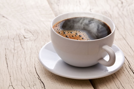 stock image of hot coffee in a cup and saucer