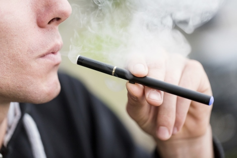 a person smokes an e-cigarette