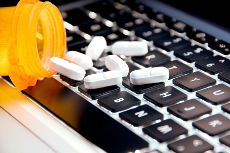 pills on a computer keyboard