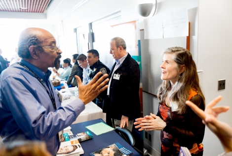 Johnnie Stanton talks with Nancy Laurenson during a Veterns Job Fair and Open House at UCSF's Parnassus campus