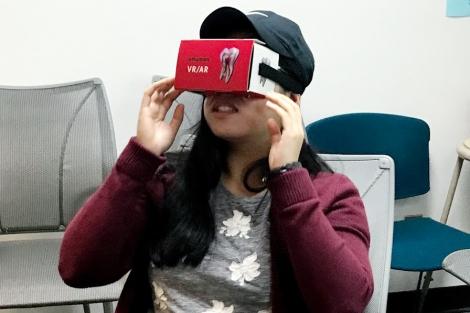 a student wears cardboard VR set