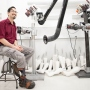Joshua Unterman sits in the Orthotics & Prosthetics workshop on the Parnassus campus.