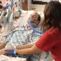 Matt Wetschler in the ICU of a hospital being treated by a nurse