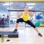 UCSF student stretches on an aerobics stepper in the gym