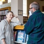 Librarian Valerie Reichert talks to a library patron