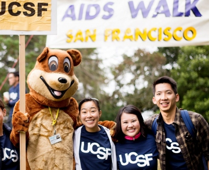 UCSF staff and students posing with Joe the Bear