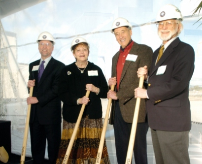 Peter Carroll, Helen Diller, Sanford Diller, and Mike Bishop pose with shovels and hard hats