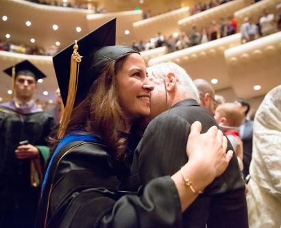 School of Medicine graduate hugs a loved one