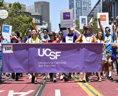 UCSF' contingent in the SF Pride Parade carries a UCSF banner down Market Street during the parade.