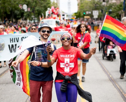 Ashley McMullen and Dhruv Kazi march in the San Francisco Pride Parade on Market Street