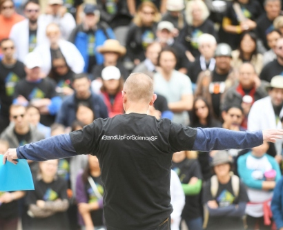 A speaker talks to the crowd during UCSF's Stand Up For Science rally at its Genentech Hall building