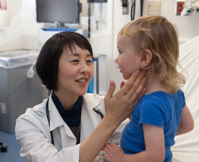 Christine Cho, MD, MPH, clinical director of the Division of Pediatric Emergency Medicine, examines a young patient.