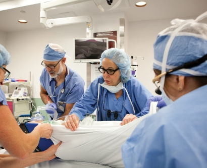Nancy Ascher, MD, PhD, at work in the operating room