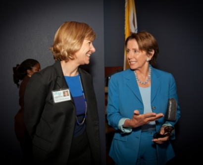 UCSF Chancellor Susan Desmond-Hellmann speaks with House Minority Leader Nancy Pelosi at the Covered Califonia town hall event on Aug. 9.