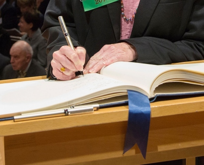 signing of the AAAS member book during the induction ceremony