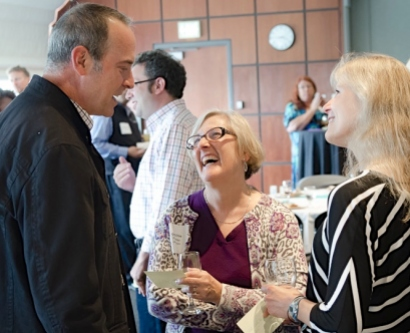 Geri Ehle, center, shares a moment with Richard Secunda at the ABOG mentorship alumni reunion event.
