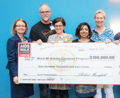 Ward 86 care team holds a giant check from AIDS Walk San Francisco