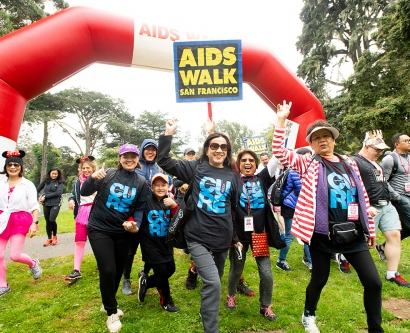 a group form UCSF walks during AIDS Walk San Francisco in Golden Gate Park