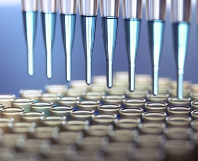 A stock image shows pipette tips filling eppendorf tubes