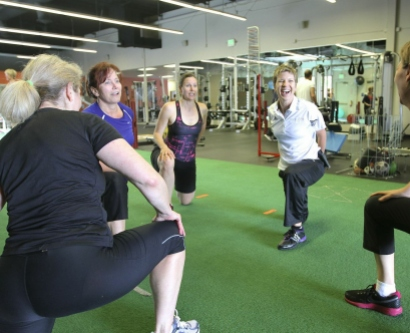 Ashley Selman shares a moment with her clients during cool-down exercises at Evolution Trainers, about a month after her total hip replacement surgery at UCSF Medical Center.