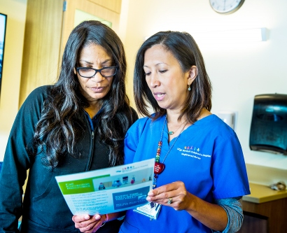 a nurse at Benioff Children's Hospital San Francisco talks with a parent about fall prevention