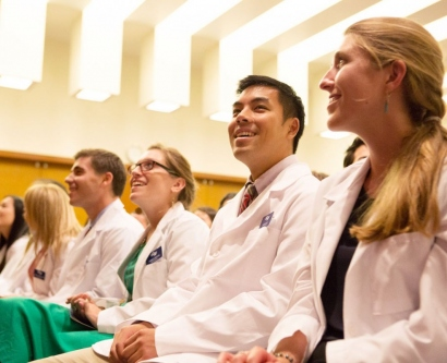School of Medicine students take in the ceremony after receiving their new white coats.