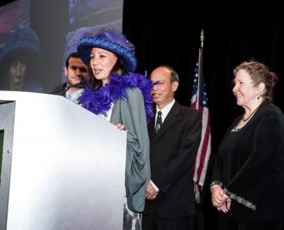Kim Dau receiving her award