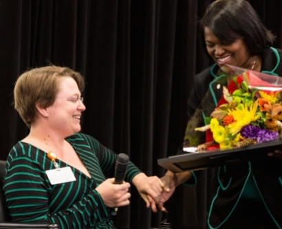 Vice Chancellor Renee Navarro, MD, PharmD, presents the Chancellor's Diversity Award to Bliss Temple, MD