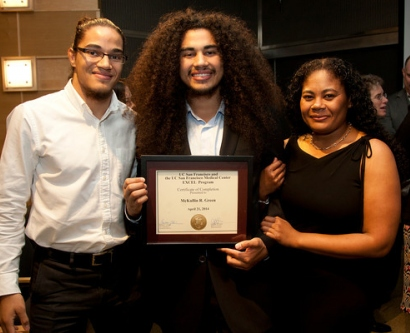EXCEL graduate McKillin Green poses with his family at the graduation ceremony.