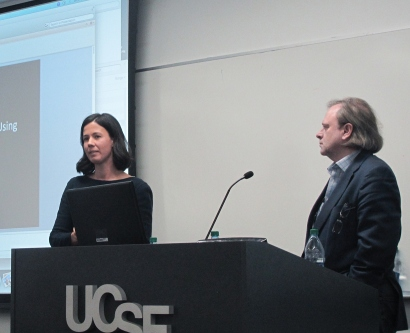 Eleni Linos presents during the UCSF Cancer Center Impact Grant live event as Alan Ashworth looks on.