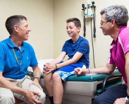 Dr. Stephen Rosenthal talks to Shay and his father, Wayne, at the UCSF Child and Adolescent Gender Center
