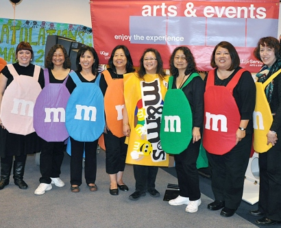 Campus Life Services' Arts & Events volunteers dress up a M&Ms for Halloween at the Laurel Heights campus