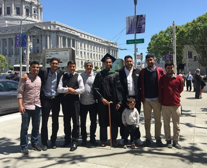 Walid Hamud-Ahmed and his family at the UCSF School of Medicine commencement ceremony